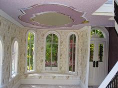 """Newly finished, The Orchid House Dollhouse with shops is a 19th century Italianate style period design piece. The new """"radiant"""" orchi..."""