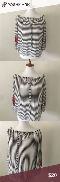 Embroidered Rose & Striped Top Like new striped knit top with trendy embroidered roses on the sleeves. Stretchy and comfortable with front tie at the neckline and can be worn off the shoulder too. 🌹 Nordstrom Tops Tunics