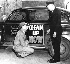 Police Chief Joe Elder and Fire Chief Mike Thompson take time out to promote a city-wide cleanup, probably about 1949.