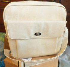 $24.99 starting bid.  Vintage Samsonite Silhouette creamy beige travel overnight tote bag MINT NICE!