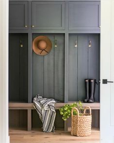 This warm wood and deep grey colored mudroom designed by couldn't be more inviting. This warm wood and deep grey colored mudroom designed by couldn't be more inviting. Entry Way Design, House Design, Mudroom Cabinets, Dark Interiors, Interior Design, Interior, Laundry Room, Home Decor, Mudroom Design