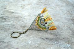 Grey triangle geometric woolen key chain with embroidery by Mioltu, €30.00