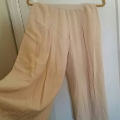 Easy Flow Beige 3/4 pants Excellent condition and material. For a cool natural earthy flow these will beautifully compliment that style. Top of pants stretches nicely for a fold over. Pants