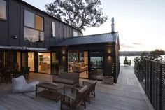 SCOTTS LANDING: The Hodgson Holiday Home sits in a west-facing steep slope overlooking stunning views across Mahurangi ...
