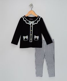 Little lovebugs will feel oh-so cool dressed in a hip ensemble bursting with color and whimsy. Designed for optimal comfort, the tunic boasts a swingy shape and all-cotton construction, while the leggings feature a hint of stretch and an elastic waistband.Includes tunic and leggingsTunic: 100% cottonLeggings: 95% cotton...