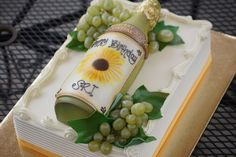 Tiered wine bottle birthday sheet cake with grapes