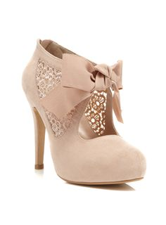 SALLY NUDE TOWN SHOE  Color: NUDE  Item code: 51S21KNDE  Step into our pretty lace mid heeled town shoe with a cute grosgrain ribbon. Heel Height 4.5in 100% Textile. Wipe Clean.