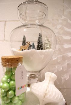 Holiday Decorations for details around the store. A new take on terrarium - maybe use dessicated coconut?>>