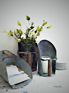 grain scoops become useful to hold; a jar of flowers, a candle, and a scoopful of greeting cards    http://www.ruralevents.blogspot.com