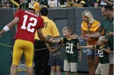Look at the expression on that kids face when Aaron Rodgers stops to shake his hand.