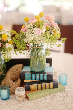 Rustic Farm Tennessee Wedding Yellow Pink Jar Flowers Books http://www.julierobertsphoto.com/