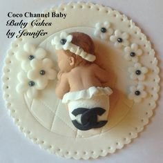 EDIBLE CAKE DECORATION coco chanel inspired baby girl fondant cake topper decorations first birthday cake flowers black and white diaper. $15.00, via Etsy.
