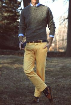 — Yellow Chinos  — Navy Leather Boat Shoes  — Dark Brown Leather Belt  — Charcoal Crew-neck Sweater  — Blue Dress Shirt
