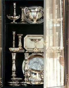 Decorate your cabinets with silver trays, candlesticks, candelabras, water pitchers & flutes