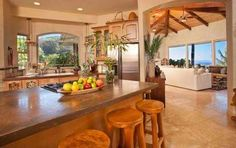Ohia Logs Carved | Tropical Paradise, Maui HI « LuxuryHomeMagazineBlog