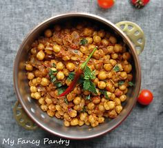 Chickpea Curry -  chickpeas cumin onion ginger chilies tomatoes turmeric coriander chili powder garam masala bay fenugreek