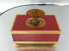 1950's Animated / Musical Red Enamerl and Brass Box with Bird - Timekeepers  http://www.timekeepersstl.com/store/home/127-bird-box-3.html