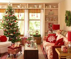 Make your living room Christmas-ready with little effort: On shelves already displaying everyday collectibles, mix in a few containers filled with Christmas cards and ornaments, dress up existing window treatments with holiday embellishments, and trim the tree in a red and green color scheme with shimmery accents of silver or white.