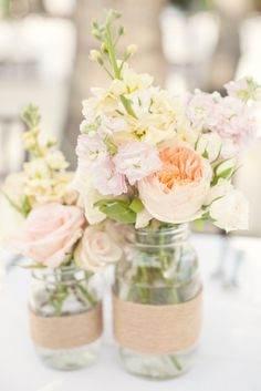 twine around mason jars holding pale petaled flowers ♥ - weddingsabeautiful