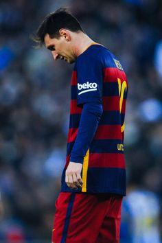 Lionel Messi of FC Barcelona looks down during the La Liga match between RCD Espanyol and FC Barcelona at Cornella-El Prat Stadium on January 2, 2016 in Barcelona, Catalonia.