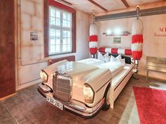 Who says you're too old for a car bed? Well, not at the Hotel. This hotel is entirely car-themed, with rooms designed around classic, vintage, and modern autos. Car Themed Rooms, Unusual Hotels, Amazing Hotels, Car Part Furniture, Furniture Ideas, Indoor Hammock, Green Environment, Car Bed, Used Car Parts