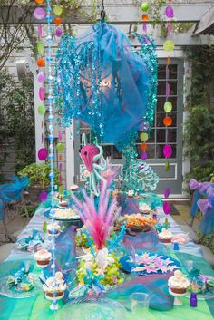 ADORABLE BOARD:  Ella's Under the Sea party....LOVE THE TOOL ON THE SEATS AND THE COLORFUL TABLE