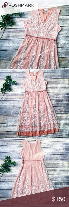 """Odille Anthropologie RARE Lace Whisper Dress  ★ Excellent condition! No flaws.   ★ This incredible peach and cream lace Whisper Dress from Odille for Anthropologie is a must have and perfect for summer and fall! HTF/Hard to find, from the 2005 Anthropologie collection.  ★ Polyester, Rayon. ★ NO TRADES! ★ NO MODELING! ★ YES REASONABLE OFFERS! ★ Measurements: Length: 40"""", Bust laying flat: 17"""", Waist laying flat: 13"""". Anthropologie Dresses Midi"""