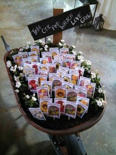 18 Cool Wheelbarrow Repurposing Ideas For Gorgeous Home And Garden Decor Check more at https:. - Rustic DIY Wheelbarrow Wedding Favor Holder 18 Cool Wheelbarrow Repurposing Ideas For Gorgeous Home - Wedding Favors And Gifts, Creative Wedding Favors, Inexpensive Wedding Favors, Seed Wedding Favors, Wedding Favors With Flower Seeds, Diy Wedding Crafts, Outdoor Wedding Favors, Sunflower Wedding Favors, Homemade Wedding Decorations