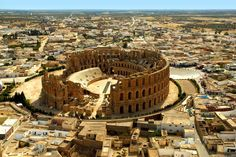 Amphitheatre of El Jem, Tunisia. The impressive ruins of the largest colosseum in North Africa, a huge amphitheatre which could hold up to 35,000 spectators, are found in the small village of El Jem. This 3rd-century monument illustrates the grandeur and extent of Imperial Rome.