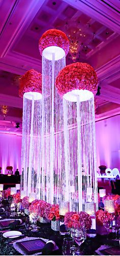 Incredible ceiling #weddingdecor with these ultra-tall crystal beaded chandeliers