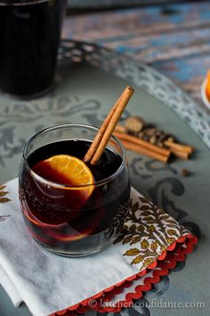 Mulled Wine (a few changes from the recipe):  Bottle of red, 2 cups cider, 2 TBSP brown sugar, sliced oranges studded w/cloves, 3 cinnamon sticks,  Dash of Pumpkin pie spice.  Simmer in crock pot, DO NOT BOIL.