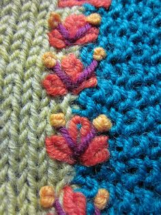 Embroidery over a seam in knit or crochet