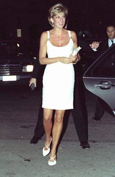 September 1995: She wore this white Versace tank dress to a concert benefiting Bosnian children.