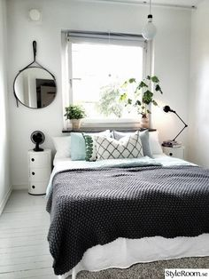 the bed infront of a window