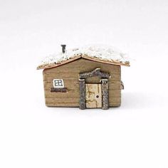 Miniature Log Cabin  Miniature Log Cabin, made from reclaimed wood. £17.50