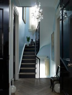 House Call: Courtney Love in New York - Remodelista Courtney Love, Fine Paints Of Europe, Blue Chandelier, Entryway Chandelier, Grand Entryway, Foyer, New York Penthouse, Black Interior Doors, Black Doors