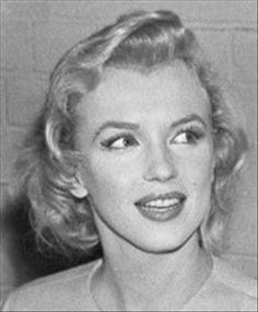 Marilyn upon her arrival in England, July 14th 1956.