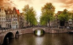 Popular songs have it that spring's the time to come tulip-plucking, but really any season in Amsterdam has its allure.