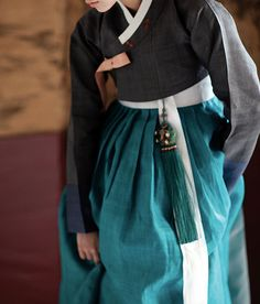 Stunning black hanbok that explicitly demonstrates restrained beauty and style. With teal color skirt and norigae (charm that goes with skirt), it is even more stylish! - Hanbok is a Korean. Korean Traditional Dress, Traditional Fashion, Traditional Dresses, Korean Dress, Korean Outfits, Modern Hanbok, Culture Clothing, Textiles, Asian Fashion