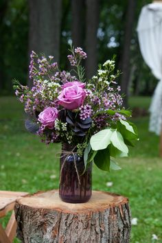Purple Rose and Wax-Flower Mason-Jar Decoration on a round of wood. Love this!