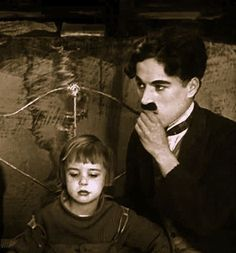 Charlie looks on worriedly as the Doctor examines Jackie Coogan in The Kid c.1921