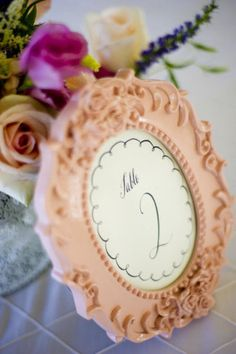 I don't necessarily love this frame, but I like the idea of using themed frames for table numbers