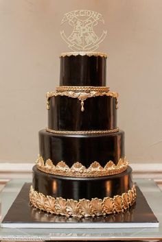 Perfectly smooth black and gold wedding cake by Palermo's Custom Cakes & Bakery.