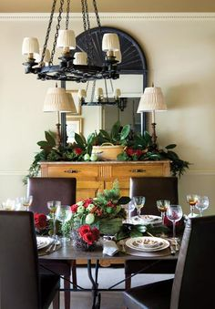 A 19th-century French walnut buffet, chandelier and mirror provide a dramatic backdrop for festive flair