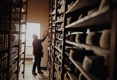 Photo by @nashcophoto // Donna Pacheco of the Achadinha Cheese Company turns wheels of cheese in the aging room of her 290-acre Petaluma dairy farm. She and her husband hand make wheels of Capricious goats cheese that is aged a year and rubbed in olive oil.  Photographed #onassignment for @natgeotravel #cheese #california Follow @naschcophoto for more adventures. by natgeotravel
