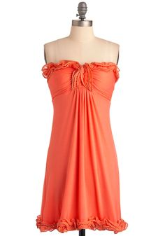 Named for the tasty punch of flavor known as the tangerine, this vibrant, silky smooth dress is sure to quench your appetite for pretty apparel. Thoroughly ap-'peel'-ing, this strapless dress is jazzed up by lettuce-edged ruffles along the hem and padded bust, and gentle gathers at the middle. Slip it on with white wedges, a charm necklace, and a straw handbag for a tastefully juicy look that can take you from brunch to the beach!