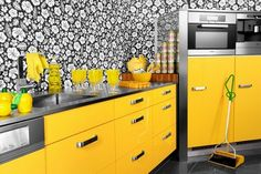 Mega retro-style kitchen with yellow cabinets and black and white floral wallpaper