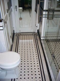 Chris' black and white bathroom remodel — amazing attention to detail — and all DIY!