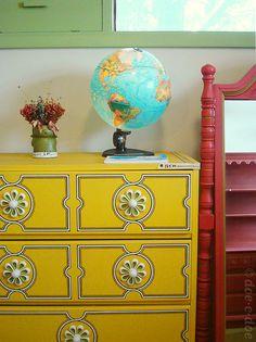 Love the yellow dresser and globe.