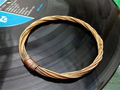 Recycled Acoustic Guitar String Bracelet bronze colored without ball ends Mens or Womens LARGE